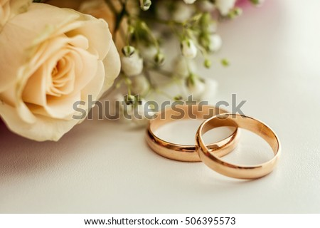 wedding rings lie on a beautiful wedding bouquet wedding rings lie on a roses - Beautiful Wedding Rings