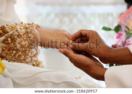 Wedding rings on brides finger