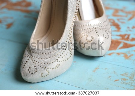 Wedding shoes on the wooden floor, women shoes, close up