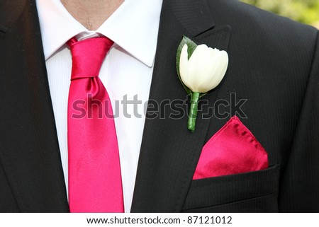 wedding suit with tie and rose buttonhole