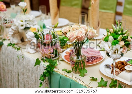 wedding table decorated with flowers and serving in the restaurant