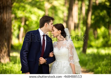 Kissing bride groom stock photo 483501997 shutterstock for Dress after wedding ceremony