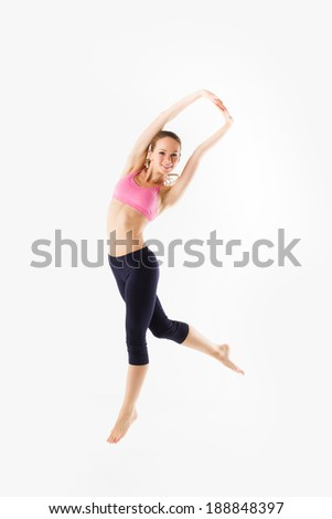 Weight loss fitness woman jumping of joy. Caucasian female model isolated on white background in full body