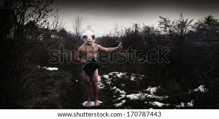 Weird naked bear head holding black suitcase hitchhike