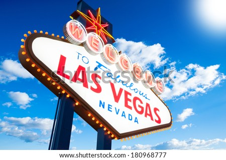 Welcome To Las Vegas neon sign on blue cloudy sky background