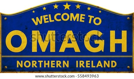Welcome to OMAGH NORTHERN IRELAND highway road text sign blue.