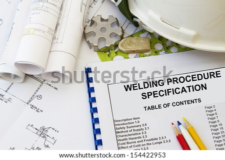 Welding procedure specification and engineering tools with hard hat.
