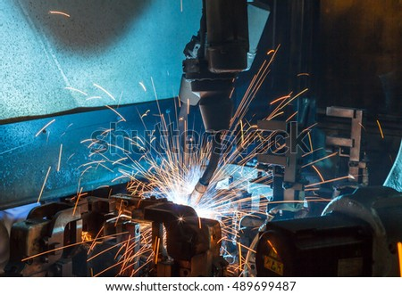 Welding robots movement auto parts in a car factory