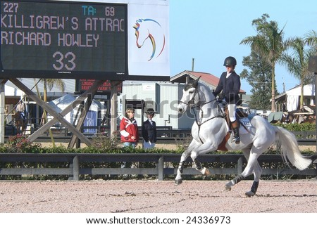 WELLINGTON, FLORIDA - FEBRUARY 1: Richard Howly and Killigrew's Attraction, competing in and winning the Junior Jumper Classic at WEF on February 1, 2009 in Wellington, Florida.