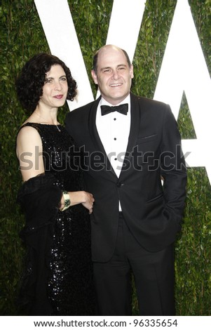 WEST HOLLYWOOD, CA - FEB 26: Matthew Weiner; Linda Brettler at the Vanity Fair Oscar Party at Sunset Tower on February 26, 2012 in West Hollywood, California.