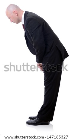 western businessman bowing isolated on white  stock photo