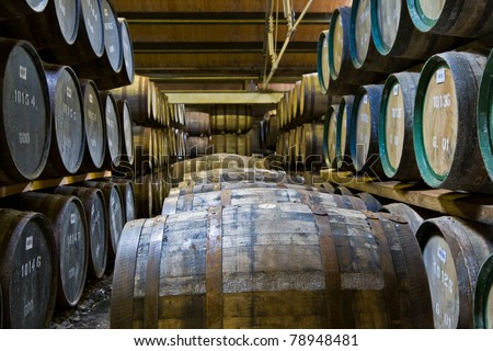 Whiskey barrels maturing in a distillery in Scotland