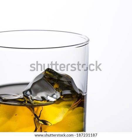 whiskey glass with ice cubes rocks close-up alcohol beverages scotland
