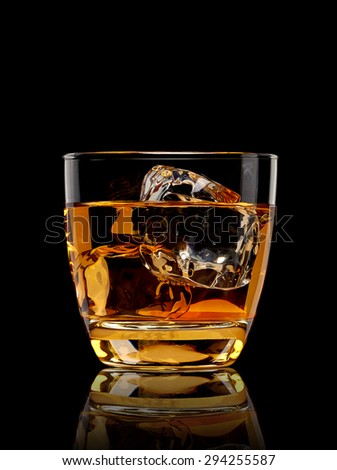 Whiskey with ice in glass isolated on black background with clipping path