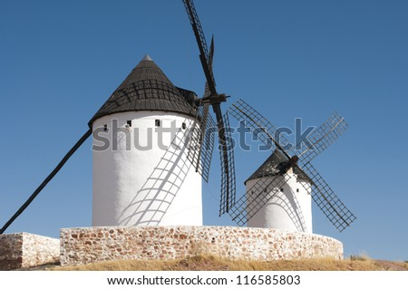 White ancient windmills. Blue sky background
