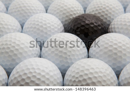 White and black golf balls in the box
