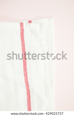 White and red line fabric on pink background.