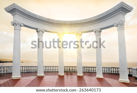 White arch with columns on a seafront