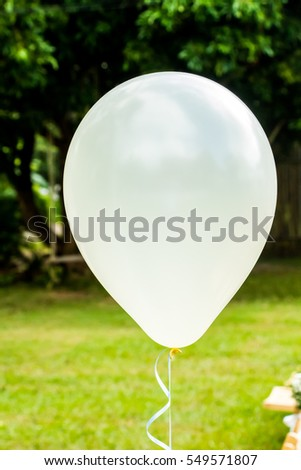 white balloon in garden