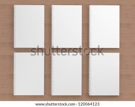 White blank notebook on wooden background