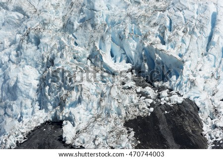 White, blue, black glacier abstract