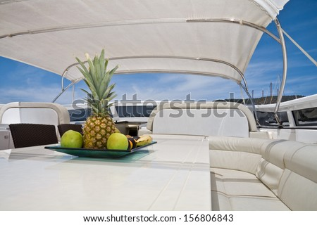 White boat lounge zone with fruits