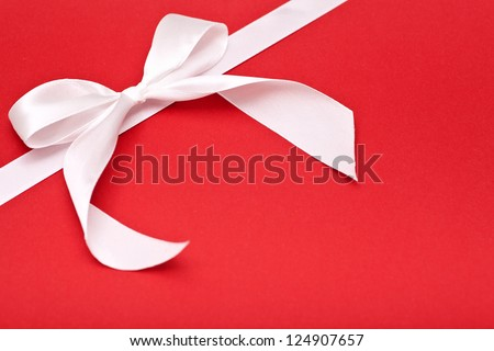 white bow on red background, holiday background