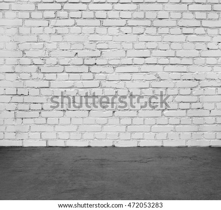 White brick wall and black floor