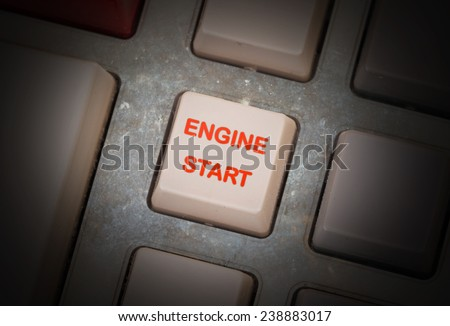 White button on a dirty old panel, selective focus - engine start