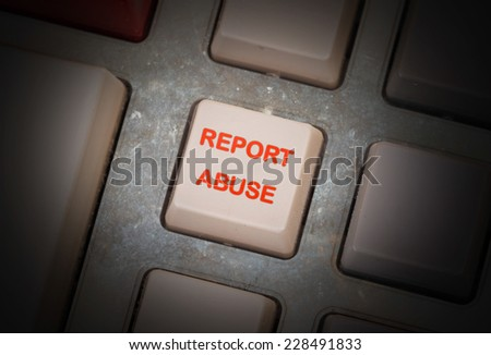 White button on a dirty old panel, selective focus - report abuse