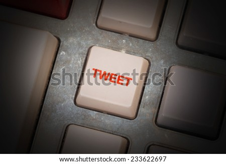 White button on a dirty old panel, selective focus - tweet