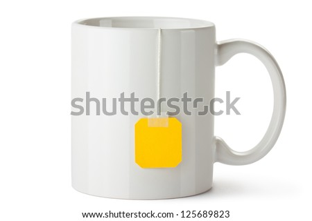 White ceramic mug with teabag label. Isolated on a white.