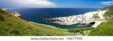 white chalk cliffs eroded coastline blue sky and sea at Caterina di Pittinuri Sardinia Italy beautiful summer panorama landscape and seascape impressive geologic rock formation