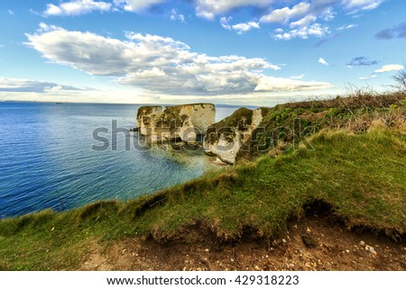 White cliffs of Old Harry rocks at dorset coast ranging into emerald colored sea