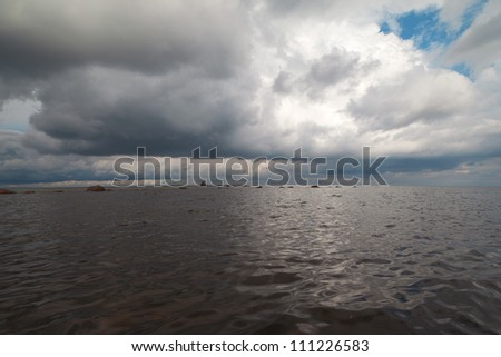White  cloud above gulf of Riga, Baltic sea.