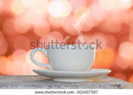 White coffee cup on the abstract circular bokeh background