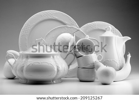 white crockery with white fruits on white background