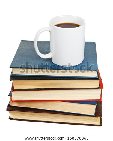 white cup of coffee on stack of books isolated on white background