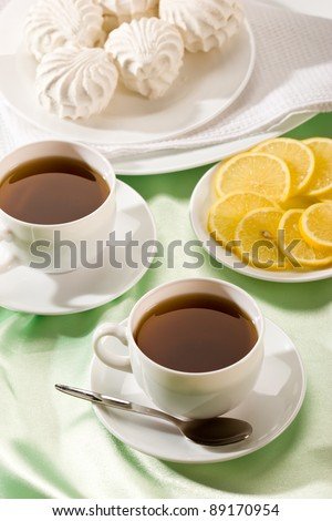 white cup of tea with lemon and zephyr, hot drink