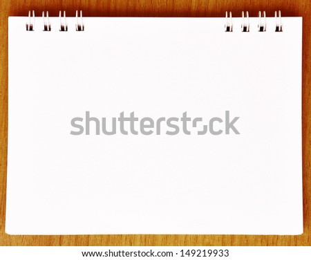white empty plain notebook paper on wood background