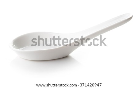 White empty porcelain spoon isolated on white background