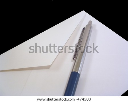 White envelope with silver and blue pen