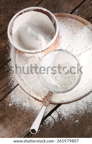 White flour on cutting board on wooden table background
