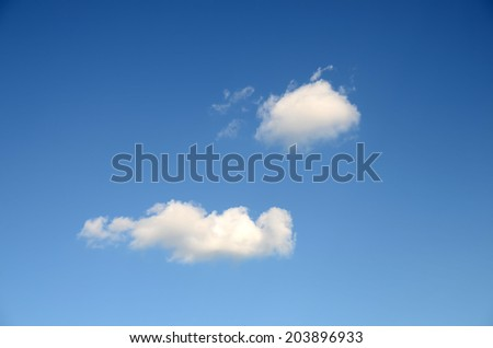 White fluffy clouds in the clean blue sky