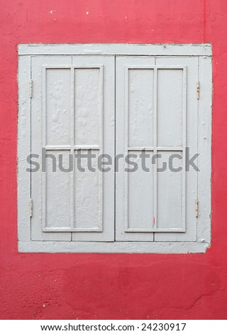 white frame window on red wall