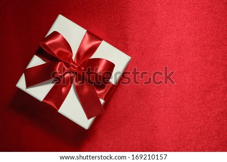 White gift box on red background