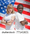 White girl and black guy outdoors. White girl and black guy against American flag - stock photo