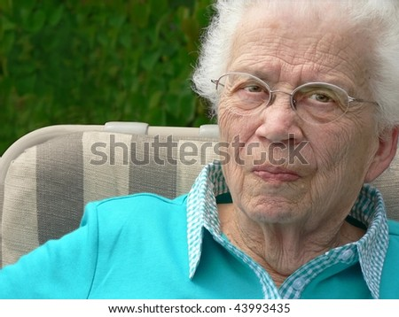 White-haired woman in lawn chair.