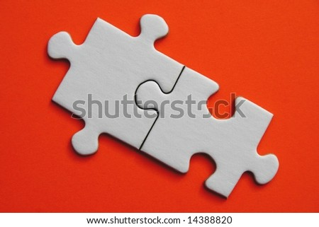White jigsaw piece on orange  background
