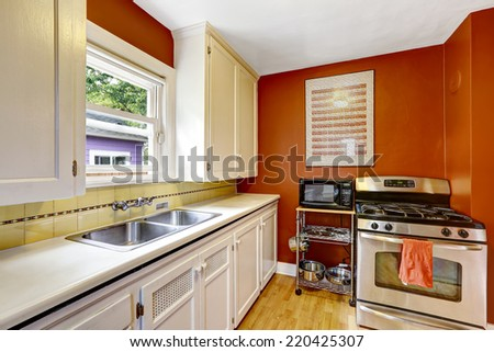 Lovely kitchen bar island hardwood floor stock photo for Bright red kitchen cabinets